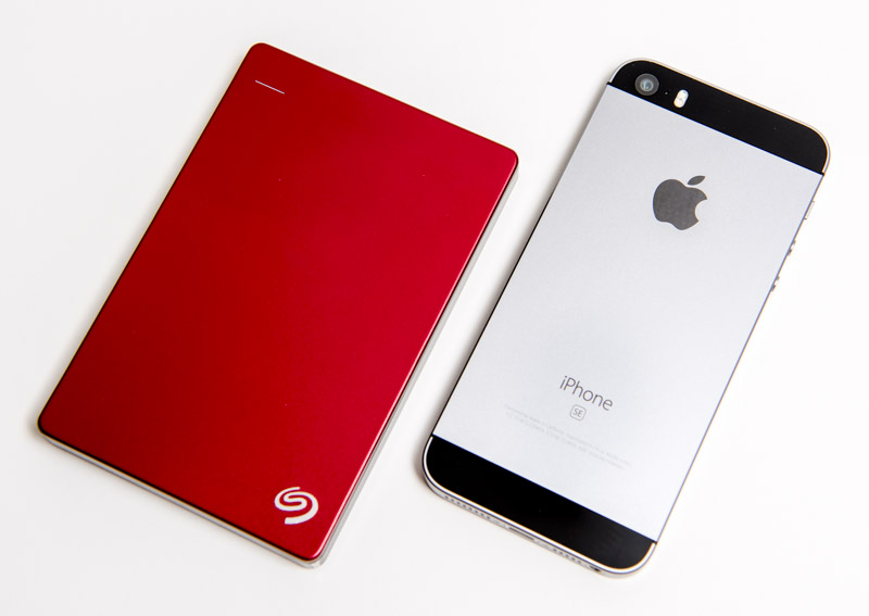 Seagate Backup Plus Slim compared to the iPhone SE